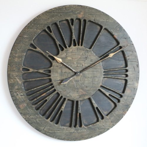Expensive Very Large Statement Wall Clock that will bring unique character to your environment. It displays hand carved Roman Numeral