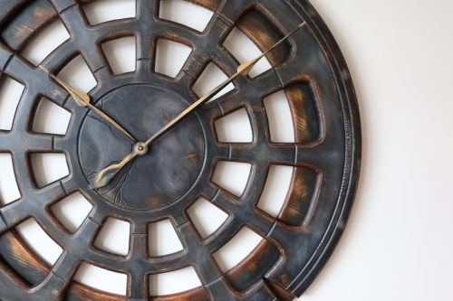 wooden grey wall clock